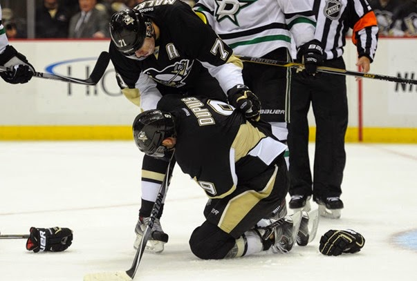 Oct 16, 2014; Pittsburgh, PA, USA; Pittsburgh Penguins right wing Pascal Dupuis (9) is help by teammate Evgeni Malkin (71) after being injured during the second period of an NHL game against the Dallas Stars at Consol Energy Center. Mandatory Credit: Don Wright-USA TODAY Sports