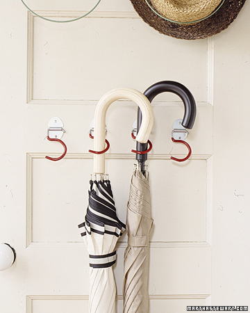 Get dry umbrellas out the way by putting them on door hooks.