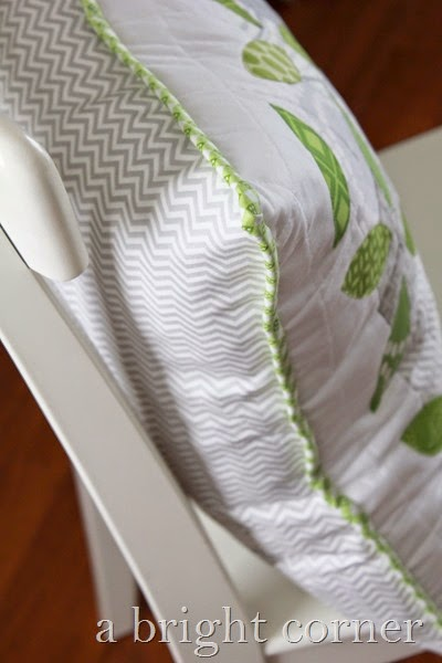 Summer Leaves quilted pillow tutorial - fun spring pillow and a great way to use scraps.  Tutorial from Andy of A Bright Corner