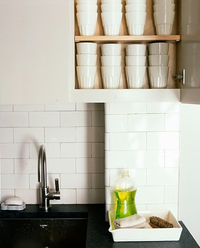 Even if you don't have the space for regular-sized cupboards, smaller, shallow cupboards are perfect for stacked cups.