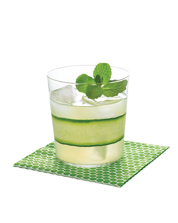 I like the idea of decorating your cocktails. Here, a gimlet is dressed up with the thinnest strip of cucumber.