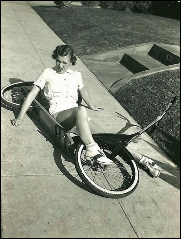 Maxine Doyle falls off an Ingo scooter bike, 1936