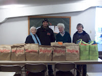 KCII's General Manager delivering food at the United Christian Baptist Church in Kalona