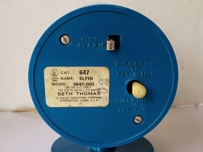 Blue Seth Thomas cylinder alarm clock back