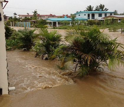 This photo from an Sydney Morning Herald reader shows floodwaters rushing down a local road in Fiji, 2 April 2012. Derrick Robinson