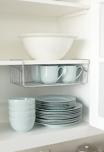 This wire rack is usually used as an inbox in the office, but it works great as an shelf accessory to hold mugs.