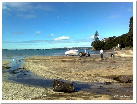 Launching a boat Kiwi style at Howick beach.