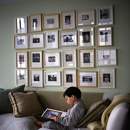 An unbound family album fills a wall. It is composed of inexpensive eight-by-ten-inch frames. The frames give consistency, while the pictures differ in size and style; some are horizontal, others vertical. Begin a grouping like this with one row or a minigrid of four frames.