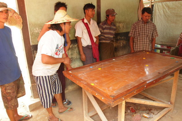 Burmese Billiards played with the hands at Inlay, Burma