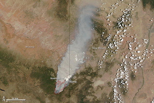 The Wallow Fire was well on its way toward becoming one of the largest fires in Arizona history when the Moderate Resolution Imaging Spectroradiometer (MODIS) on NASA's Aqua satellite took this image on June 4, 2011. Winds and hot, dry conditions helped the fire grow quickly in the week after it ignited on May 29. Red outlines the fire in this image. NASA image courtesy Jeff Schmaltz, MODIS Rapid Response Team at NASA GSFC
