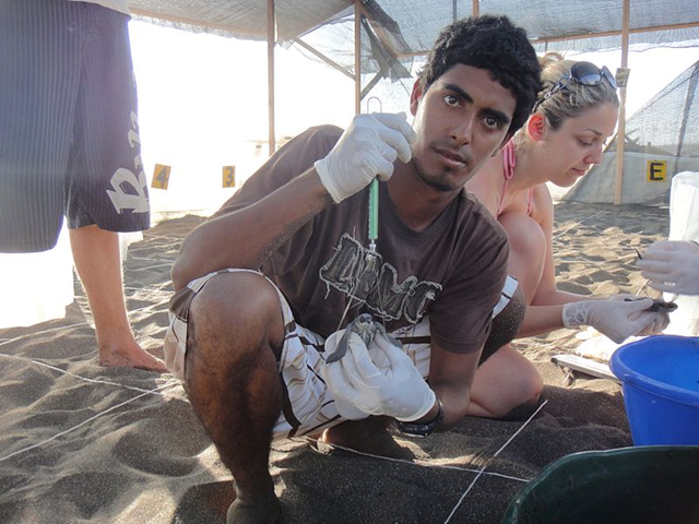 Environmentalist Jairo Mora Sandoval on the beach with fellow WIDECAST volunteers. Jairo Mora, 26, had warned of receiving death threats from alleged drug traffickers or poachers days before he was murdered on Moín Beach, on Costa Rica's Caribbean coast. Photo: Christine Figgener / Wikimedia Commons