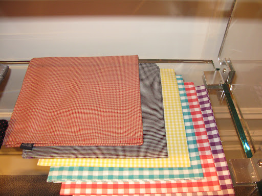 Vibrant gingham pocket squares at Kleinfeld.