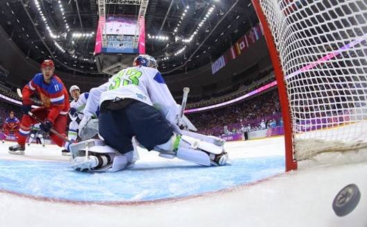 Yevgeni Malkin #11 of Russia scores on Robert Kristan #33 of Slovenia in the first period during the Men's Ice Hockey Preliminary Round Group A game on day six of the Sochi 2014 Winter Olympics at Bolshoy Ice Dome on February 13, 2014 in Sochi, Russia.  (Photo by Bruce Bennett/Getty Images) ORG XMIT: 461426919