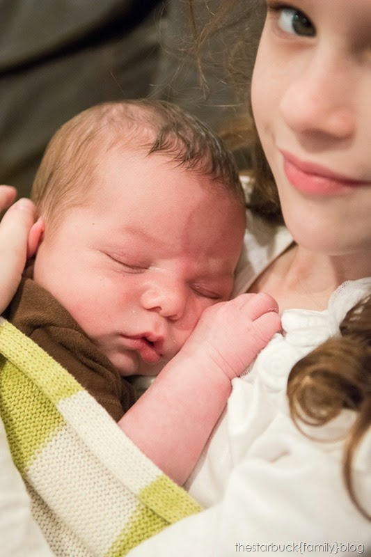 Abby holding sleeping Ethan blog-3