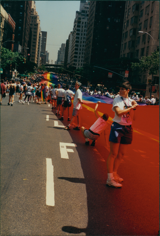 Giant rainbow flag on 1st Avenue at the Stonewall 25 parade. June 26, 1994.