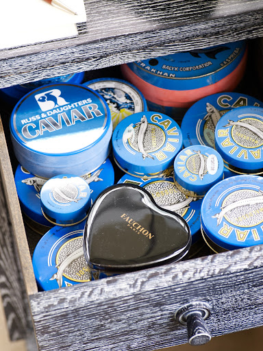 I use caviar tins that I've collected over the years to contain push pins, paper clips, rubber bands, etc.