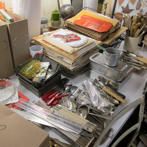 Fritz organizes his collections by the type of object–vintage spoons, rulers, and food storage containers all have their place.