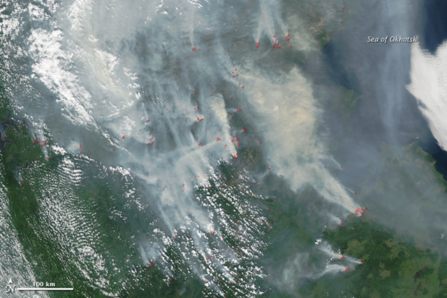 This image, taken by the Moderate Resolution Imaging Spectroradiometer (MODIS) on the Aqua satellite, shows fires burning in parts of Khabarovsk, Amur, and Sakha (Yahkutiya) on July 28, 2011. The large image (download) shows many more fires across the broader region. The fires are marked in red. The Russian government reported 19 large fires in this region on July 28, and RIA Novosti, a Russian news agency, reported 41 fires on July 29. NASA image courtesy Jeff Schmaltz, MODIS Rapid Response Team at NASA GSFC