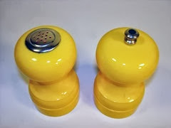Yellow plastic set of salt shaker and pepper mill by Peter Piper