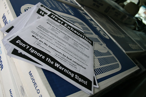 Papers warning about the dangers of heat exhaustion are to be handed out with each fan. (photo credit: James Mulvenon)