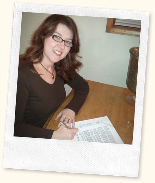 signing the GC contract for Love in the Balance books 1 & 2