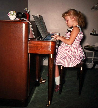 Judy at the piano 1950s_edited-1