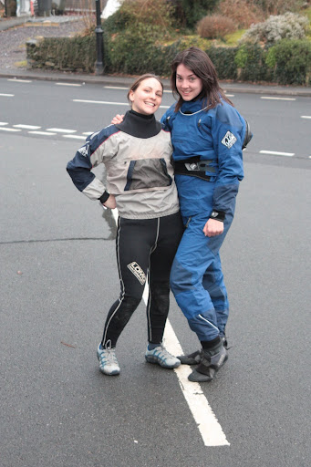 Amy helping Emma show off her new drysuit