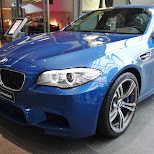 blue bmw m5 limousine at bmw welt in Munich, Bayern, Germany