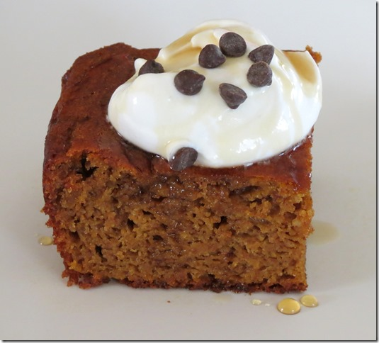 Grain Free Pumpkin Gingerbread Cake with whipped coconut cream and maple syrup