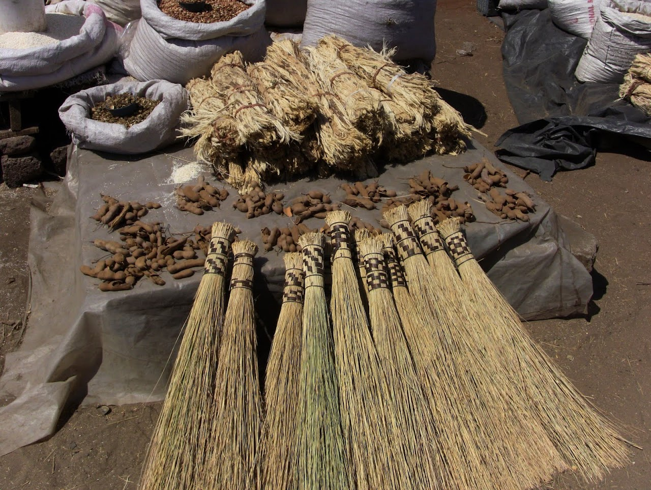 Brooms and tamarind pods
