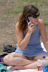 Girls using cell phones always forget to keep their legs closed