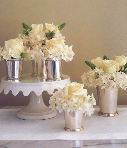 A five-part arrangement for a buffet uses paper-whites -- easy to force in winter -- roses, and ornithogalum in silver julep cups. (The Best of Martha Stewart Living -- Arranging Flowers)