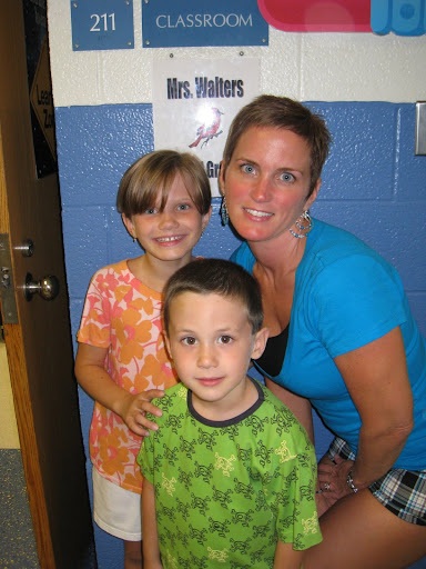 Natalie, Eli, and Shelley pose outside Ms. Walter's room.