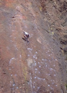 You can see the permanent anchor for the ropes attached to the wall above the climber's head.