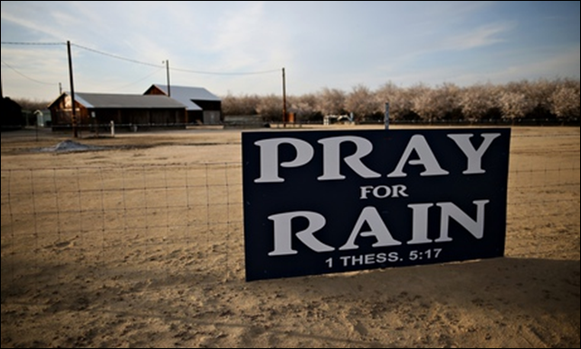 A sign in Turlock, California reads 'Pray for Rain 1 Thess 5:17'. Water scarcity has had a severe effect on energy production in Turlock, as well as agriculture. Photo: Justin Sullivan / Getty Images