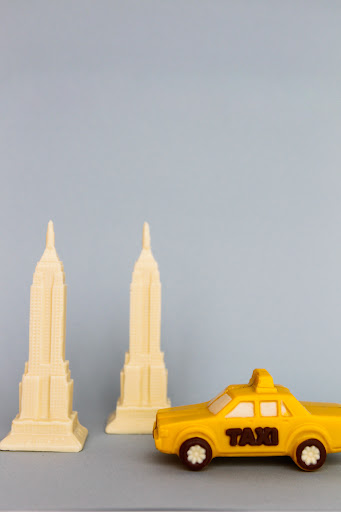 Edible white Empire State Buildings for the bride and groom, and taxis by Martine's Chocolates are the perfect party favor for a NYC-inspired wedding.