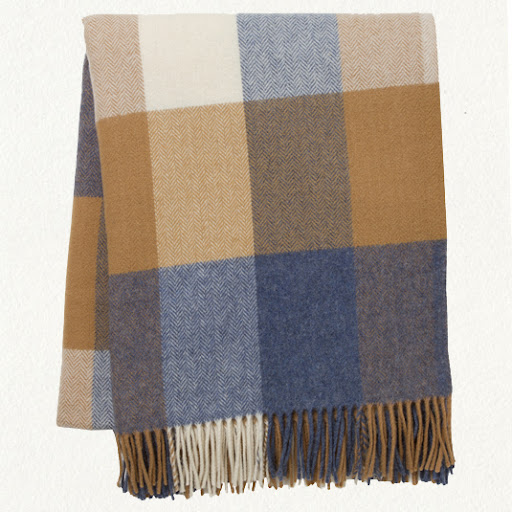 The color palate of this plaid throw is great and very camp-inspired. (shopterrain.com)