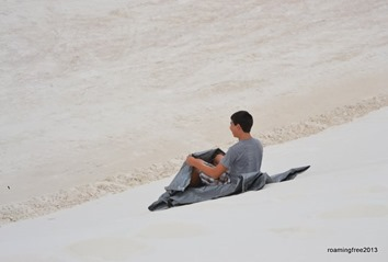 Trying to sled down the dune