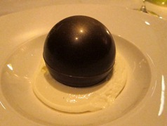 Chocolate sphere with milk ice cream and honeycomb