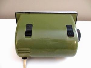 green Bulova B 5410 flip alarm clock back