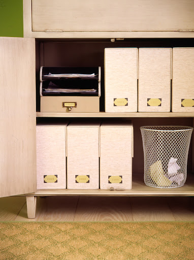 To maximize your storage, use space below the drop down desk for fills and a waste bin.