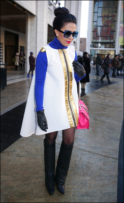23 w ultra modern dress with gold trim blue turtle neck knee high boots black with silver studded gloves bright pink purse ol