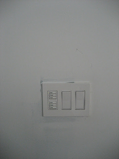 The wall switch in the dining room has both motorized shade and light controls for the dining room and living room. Lutron (www.lutron.com) makes a great selection of dimmer switches.  I know I will definitely be adding some here.