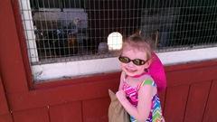 Bella 7.18.13 Plymouth farm feeding chickens