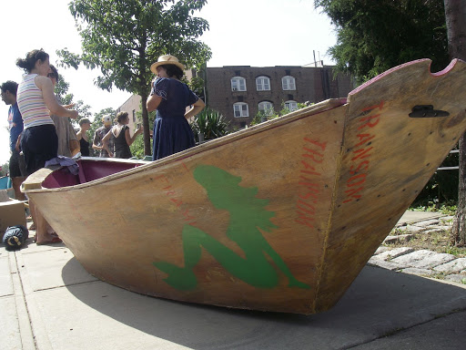 "Hipster eco-art boat. I was told that the story with these boats was that they were made entirely out of found materials and cost almost nothing to build. Looks it too, doesn't it? Think I'll stick with my ""boughten"" boat."