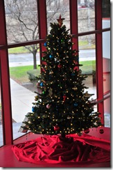 A colorful holiday tree greets visitors in the lobby.