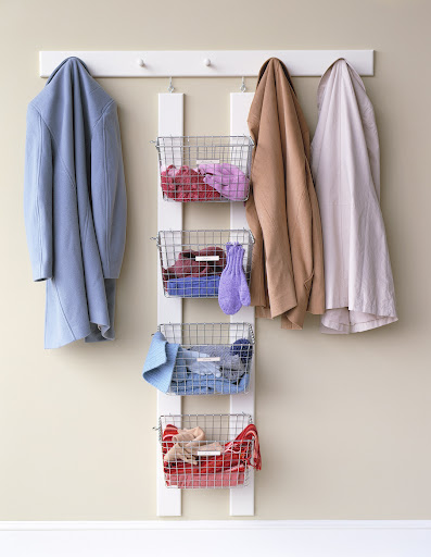 You can create this temporary winter accessories storage with wire racks, wood rails and hooks. At the end of the season, simply dismantle and store until next winter.