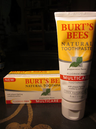 Burt's Bees makes great toothpastes with subtle mint and thick texture, 100% natural without flouride and 99.2% natural with it, all in convenient upright tubes. ($4.99 for 4 oz)
