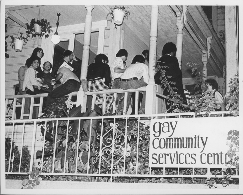 A crowd on the porch of the Gay Community Services Center. Circa 1971.