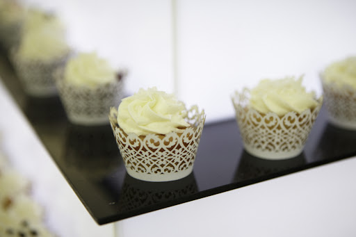 All white iced cupcakes for the party.